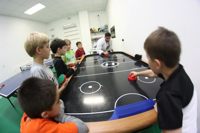 Air Hockey Hits Team Third Law's Naples Best Summer Camp.